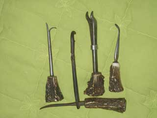Antique dental Reindeer handled tooth extractors